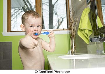kid or child  brushing teeth in bathroom