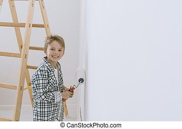 Kid painting a wall