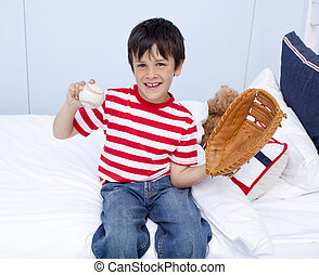 Kid playing baseball in his bedroom