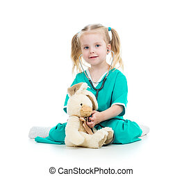 kid playing doctor and examining toy