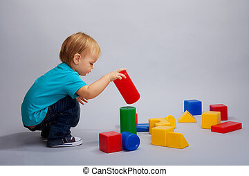 Kid playing with blocks