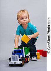 Kid playing with cars
