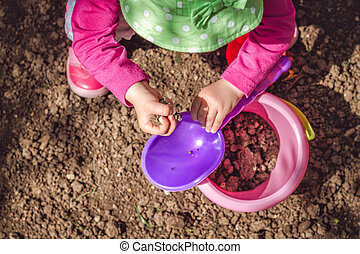 Kid playing with dirt
