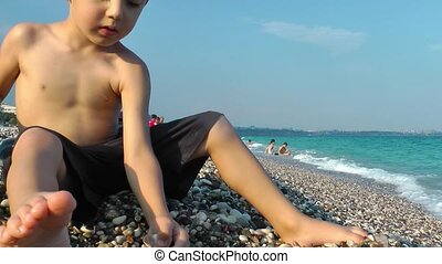 Kid Playing with Rocks