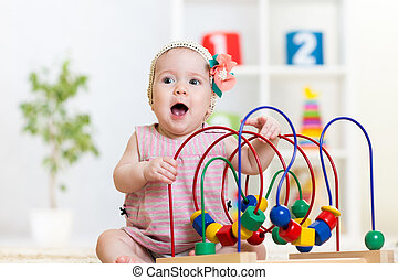 kid plays with educational toy - kid girl plays with...