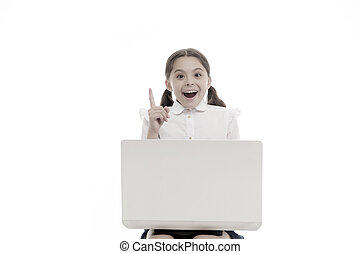 Kid point finger up isolated white. Schoolgirl with laptop pointing upwards. Schoolgirl having idea or recommend check this out. This direction. Subscribe or check. Push button turn on notification