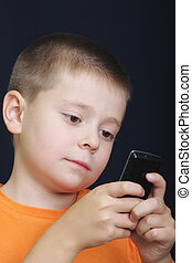 Kid reading message on cellphone