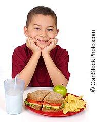 kid ready to eat a sandwich lunch - eight-year-old boy ready...