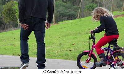 kid ride bicycle in  a park
