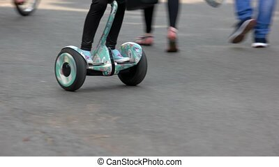 Kid riding on hoverboard gyroscooter.
