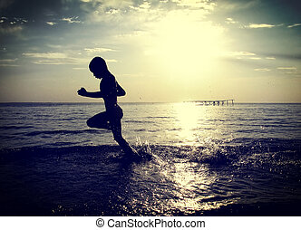 Kid running in the Water