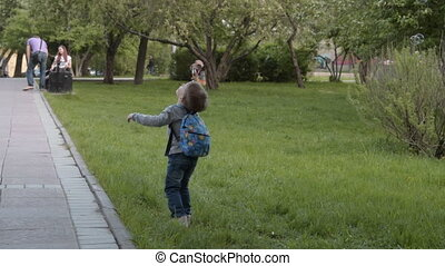 Kid running with soap bubbles in the park