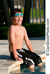 Kid seated in the pool