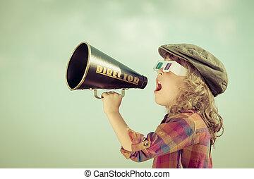Kid shouting through megaphone - Kid shouting through...