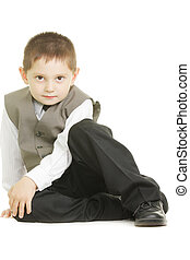 Kid sitting on white ground
