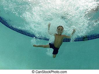 kid smiling underwater in swimming pool