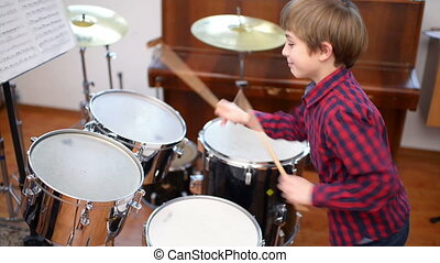 Kid Studying Drums - Kid studying drums at school