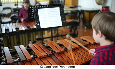 Kid Studying Percussion Instrument - Kid studying percussion...