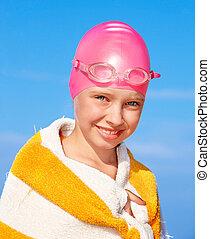 Kid swimming in pool.
