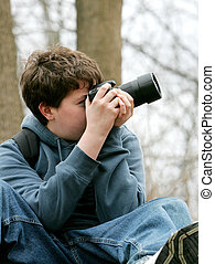 kid taking photos - young teen boy taking photographs with ...