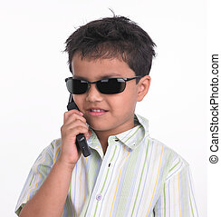 kid talking in his cell phone