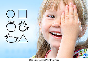Kid testing vision with symbols. - Close up face shot of ...