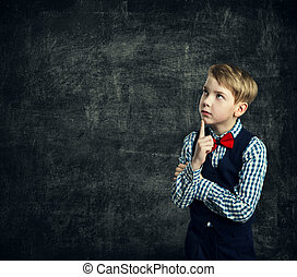 Kid Thinking Over School Blackboard, Child Boy Think Looking Side Finger on Chin, Children Education