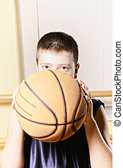 Kid throwing basketball