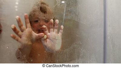 Kid touching glass in bathroom - Child taking wet glass...