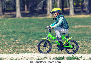kid training with bicycle