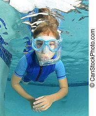 kid underwater in pool