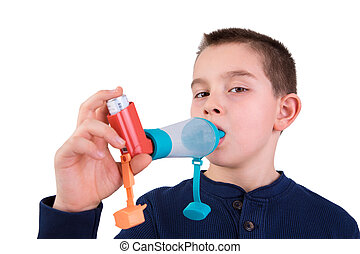 Kid using Inhaler with Spacer - Nine years old kid with...