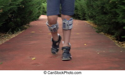 Kid walking with foot drop system - Child walking outdoor...