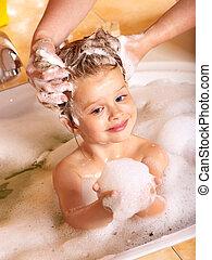 Kid washing hair by shampoo . - Child washing hair in bubble...