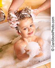 Kid washing hair by shampoo . - Child washing hair in bubble...