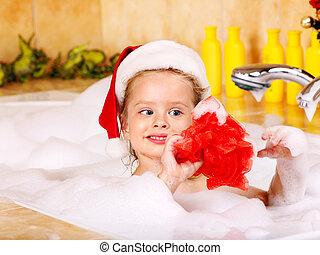 Kid washing in bath. - Child washing in bubble bath .
