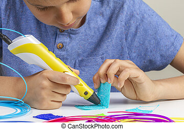 Kid with 3d printing pen creating new item
