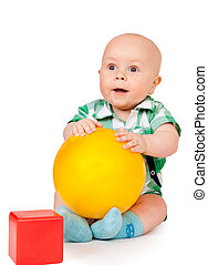 Kid with a red cube and yellow ball