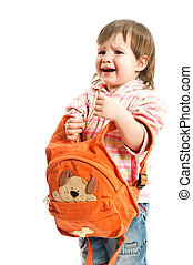 A little baby trying to wear a rucksack and crying