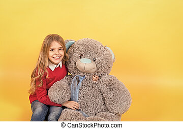 Kid with animal doll, present and gift