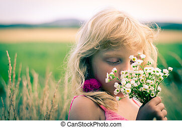 kid with bunch of flowers