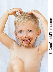 Kid with chocolate on his face