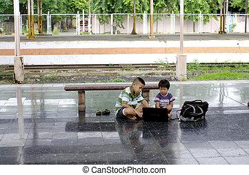 kid with computer on floor