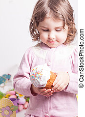 Kid with easter cake