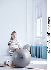 Kid with exercise ball