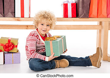 Kid with gift boxes and shopping bags