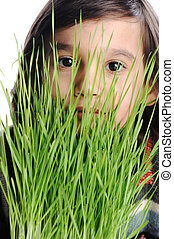 kid with grass