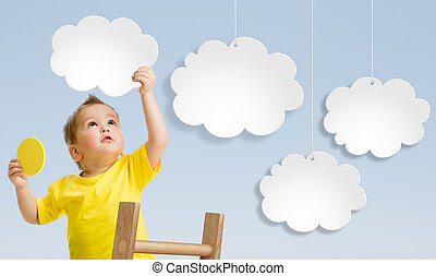 Kid with ladder attaching clouds to sky concept - Kid with...