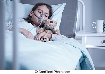 Kid with oxygen mask