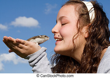 kid with pet hamster